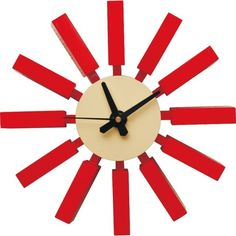 Enjoy this postmodern clock design, ideal for any area in your home or business. Very retro, this wall clock features painted wood spokes for an eyecatching design. Colors/finish: Red, blue, natural M