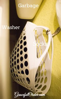 Dollar tree basket on wall next to washer (under trash bag holder) for lost socks.  Use command hook.