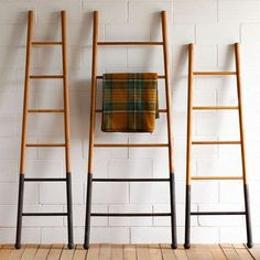The Bloak Decorative Ladders marry the classic silhouette of a ladder with distinctive details. Available in three sizes, each ladder is made of strong oak wood that is ideal for hanging bath towels, linens, or scarves. The bottom of each ladder features a black oxidized finish, giving the ladders additional visual appeal.