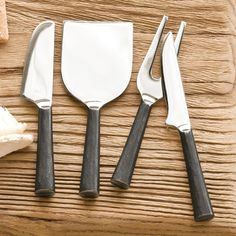 """ARTISAN CHEESE KNIVES, SET OF 4--Designed especially for those occasions when the cheese stands alone, our cutlery is forged from solid pieces of stainless steel finished with rustic blackened handles. Set of 4 assorted tools. Hand wash only. Exclusive. 5-1/2 to 6""""L."""