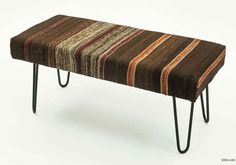 Bench upholstered with vintage Turkish kilim rug. Hairpin legs add a modern look. We use hand crafted steel legs specially coated and oven cured so they would not rust or peel. Kiln dried hardwood frame. This one-of-a-kind benchwould serve as a practical and aesthetically appealing addition to yourthe living room, bedroom or hallway. Please contact us if you prefer other rugs or flatweavesfor upholstery or other colors for the legs. Tiny rubber shoes included for protection on wooden…