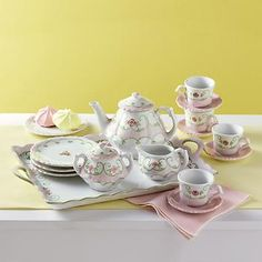"""Your child will have hours of fun playing with our """"Eloise Floral"""" tea set with cookie plates and serving tray. This 12-pc. set is handmade of porcelain. Hand painted with delicate pink flowers on a green leafy vine and topped with flower finials on the teapot and sugar Bowl. Set includes: One 12 oz. Teapot 4.25""""H X 4.25""""W X 6.25""""L, One Sugar Bowl 2.75""""H X 3""""W X 3.75""""L, One 3 oz. Creamer 2""""H X 2.75""""W X 3.25""""L, Four 4.5"""" Diameter Dessert Plates, Four 1.75 oz. Tea Cups 1.75""""H, Four 3.25""""…"""