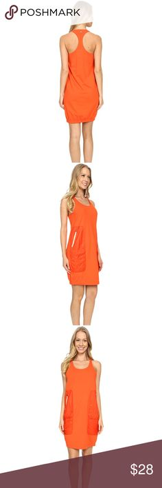 """Merrell // Around Town Tank Dress Merrell // Mandarin Red/Orange color Excellent condition; new without tags! Length 34"""" Bust 32"""" Kick back and relax with friends in this Around Town Tank Dress. Regular fit top in a soft jersey material. Binding at the neckline and armholes. Scoop neckline. Sleeveless construction. Racerback styling allows arms complete range of movement. Nylon ripstop hand pockets with lockdown zip-closures. Straight hemline. Shell 1: 58% cotton, 38% polyester, 4% spandex…"""