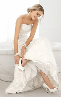 Make your day even more magical in this whimsical wedding dress. This designer dress features delicate and stylish Lace and is accented with a detachable beaded satin belt.