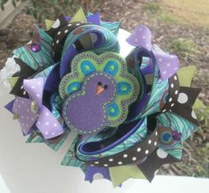 Purple Peacock Feathered Friend Large Over The Top Boutique Hairbow. $10.50, via Etsy.