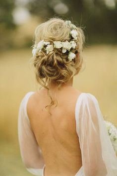 curly updo with white flowers