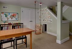 basement after finished playroom from Hooked on Houses.  Love the secret room under the stairs