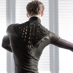 "A team at MIT Media Lab has used ancient bacteria to design a ""bio-skin"" fabric that peels back in response to sweat and humidity"