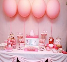 The tablecloth, super cute! Was against balloons, but a few oversized pale pink, uniform behind one of the tables?? Kinda cute