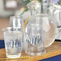Clear 16 ounce size disposable soft plastic cups custom printed with a wedding design or monogram along with the bride and groom's name and wedding date hold beer, lemonade, soft drinks, or iced cocktails at your wedding reception.