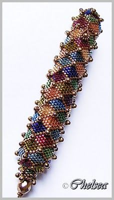 This is so beautiful! It is a needle case. Harlequin. I would love to make this as a bracelet.