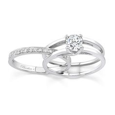 This classic designed interlocking diamond wedding set features a solitaire engagement ring sporting a prong set round diamond center while a split shank at the bottom is designed to lock the wedding ring in place when it's on the finger. The wedding band sports pave set diamonds with a milgrain finish that can easily be worn alone for a casual look or slipped into the engagement ring for a more sophisticated elegant look.Also available in 18k and Platinum.