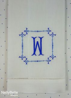 A chinoiserie monogram in blues is embroidered on this linen guest towel. NellyBelle Designs