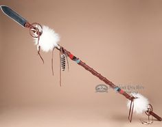 This is a decorative Native American Lance or as we always knew them, an Indian spear. This beautiful American Indian lance is wrapped with genuine leather and has bands of impressive hand bead work.N