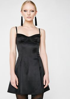 Current Mood Spotlight On Me Slip Dress cuz you luv bein' center stage. This black satiny mini dress has a bustier-style top, a slim fit thru the waist, and back zipper closure.