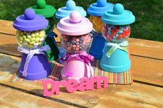 Bubble gum machine dispensers.  Could be a favor or for the dessert table