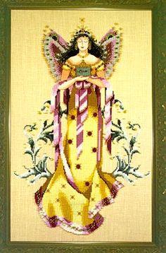 Fairie Treasures - Mirabilia Cross Stitch Pattern. Model stitched over 2 threads on 32 count Light Mocha Belfast using DMC floss, Kreinik Metallic Thread and Mi