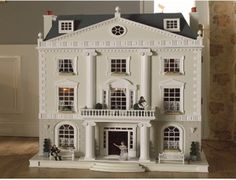 The Grosvenor Hall dolls house kit in 1/12 scale from the Dolls House Emporium is a beautiful Palladian-style house exuding grandeur and timeless elegance with its magnificent entrance hall, impressive balcony and ionic columns. Inside, the elegance is reflected in the exquisite curved staircase, internal doors and working sash windows.