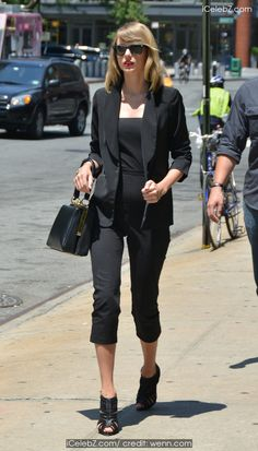 Taylor Swift  spotted out in New York wearing all black carrying the Dolce & Gabbana 'Sara Handbag' http://icelebz.com/events/taylor_swift_spotted_out_in_new_york_wearing_all_black_carrying_the_dolce_gabbana_sara_handbag_/photo1.html