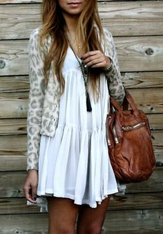 leopard sweater over a light white dress! cute bag too