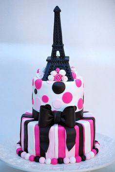 Cool cake with Eiffel tower. Red, white, black.cute,pretty,beautiful,etc......................................................................................................................