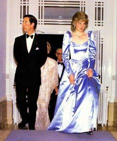Di is Stunning in that dress n Charles can't even look at her..he's n ASS!