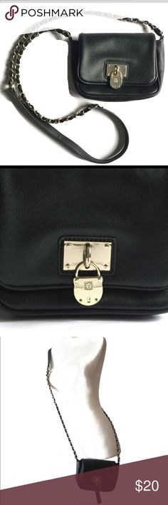 Anne Klein crossbody purse -Gorgeous black bag with chain style strap and lock charm on front with the Anne Klein lion  -Bag measures 5in. high x 7in. across x 2.5in. wide -Strap measures a total of 50in. around -Red lining inside, silver tone hardware, all man made materials  -Preloved, used for 1 occasion, EUC Anne Klein Bags Crossbody Bags