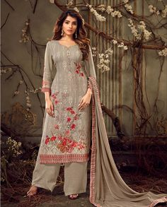 Flaunt Your Rich And Elegant Taste In This Designer Straight Suit In Subtle Grey Color. Its Top Is Georgette Based Paired With Shantoon Bottom And Chiffon Fabricated Dupatta. Its Rich Color And Tone To Tone Embroidery Gives A Heavy Yet Subtle Look To Your Personality. This Palazzo Suit Can Be Stitched Up Bust Size 42 Inches