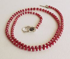 Luscious Rubies that I just had to purchase. It started off as a 17 strand of graduated faceted rubies that go from 4.40mm to 6.30mm. Well that sure is not long enough for a necklace so I added some wonderfully cut Sterling Silver beads. Also a very nice Sterling Silver clasp on this fantastic 31 necklace that is pure beauty. Rubies are the July Birthstone. OK guys, this is a special birthday, anniversary or holiday gift or if your in the dog house, what a perfect piece this is.   I am a…