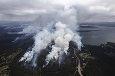 Bush fires burning amongst Chain Valley Bay and Catherine Hill Bay on Lake Macquarie.