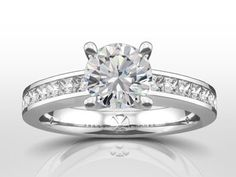 4 Claw solitaire with channel set princess cut side stones