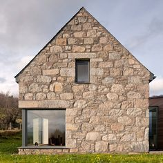 A modern glass structure connects the traditional stone-walled buildings by this house in the Scottish highlands by architects Stuart Archer and Liz Marinko