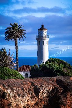 """LIMITED TIME SALE 15% OFF This Photo Coupon code: SALE15OFF  Blue Sky Point Vicente Lighthouse  Original by PhotosbyJerryCowart, $38.50  Blue Sky Lighthouse Palos Verdes Peninsula Original Fine Art Photography a Gift For Your Home  Title: Lighthouse - Lighthouse on the Cliffs   Image size: 8""""X12""""   MORE OF MY PHOTOGRAPHS CAN BE SEEN AND PURCHASED ON MY WESITE: jerry-cowart.artistwebsites.com"""