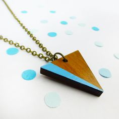 Geometric triangle necklace | Blue jewellery | Wooden necklace | Accessories with bold pops of colour | Simple modern shape | Blue necklace
