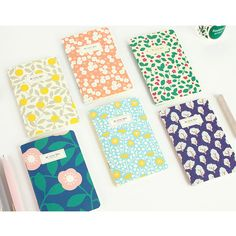 Promenade flower pattern mini lined notebook by Livework. The Promenade lined mini notebook is perfect for taking notes and anything you can think of.
