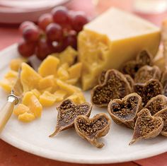 Serve heart-shaped figs with cheese and fruit on V-Day.