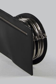 Half Measures Peel Back Clutch - A sculptural flat clutch with three kiss-lock closure side compartments and single back zip compartment, constructed from semi-gloss vegetable tanned leather. Vegetable Tanned Leather, Kiss, Closure, Flat, Bass, A Kiss, Kisses, Dancing Girls, Flat Shoes