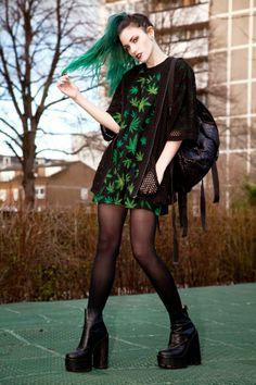 Alternative pastel goth. Green long hair.