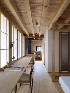 Long wood desk against wall of shoji screens in bedroom of Yatsugatake Villa in Hokuto-Cotu, Japan