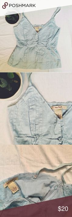Free People baby doll tank size 2 Free people baby doll tank cropped top. Baby blue color. Side zipper. Distressed edges. The straps can convert into a halter top. Sized as a 2, best for an XS/S. Free People Tops Camisoles