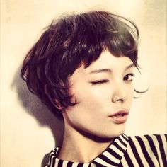 I love this cut but you need the bone structure for it: short bangs short hair