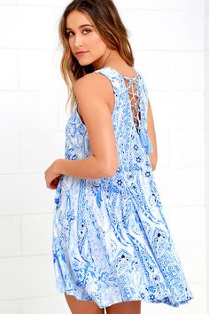 Get wrapped up in the comfort and cuteness of the Spellbound Skies Blue Print Lace-Up Dress! Sleeveless princess-seamed bodice with rounded neckline (made of lightweight woven rayon) transitions into godets on the flaring skirt. Lace-up back detail with tasseled ends.