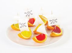 Pirate party food. I like the flag in the oranges and the banana 'boat'
