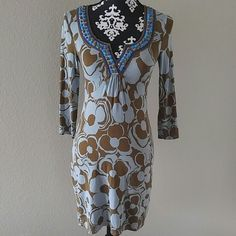 """Boden 3/4 sleeve tunic dress Boden 3/4 sleeve tunic style dress. Gorgeous beaded v neck. Light blue and brown floral print. Jersey knit. 95% viscose, 5% spandex. Soft and stretchy. U.S. Size 2. Worn once or twice EUC.? Measurements laying flat NOT stretched:? Shoulder to Shoulder: 13.5""""? Underarm to Underarm: 15""""? Length: 32.5"""" Boden Dresses"""