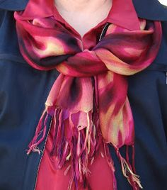 This is a variation of the loop and tuck (http://www.scarves.net/blog/loop-and-tuck-scarf-knot). Keep the ends the same length when looping instead of the way it's shown in the instructions shown in the link.) Instead of tightly tucking the ends through the loop I pulled them up to drape over the top of the loop. It works best on a very long scarf because the hanging pieces end up longer. I am calling this Loop, Tuck, and Drape…