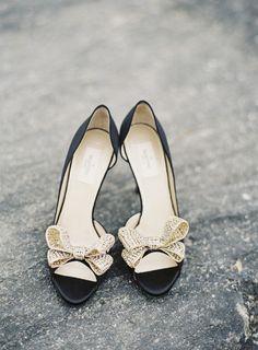 Black and gold Valentino wedding shoes: http://www.stylemepretty.com/new-york-weddings/new-york-city/2015/01/01/glamorous-black-gold-inspiration-shoot/   Photography: Matthew Ree - http://www.matthewree.com/