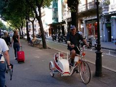 A man riding his bicycle down La Rambla with his dog in a sidecar. Too cool. #bringfido