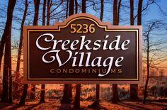 #condo #condominium #subdivision #customsigns #builder #homedeveloper #hoa #signs Strata Sign Company Creekside Village Condominiums Condominium Signs www.customoutdoorwoodensigns.com