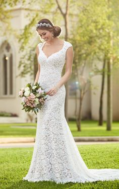 This one-of-a-kind wedding gown from Stella York gives a glimpse of skin, and is made from fine lace over rich Lustre satin.