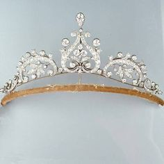 An Edwardian diamond tiara, circa 1905. A lovely lyre and foliate scroll design, diamonds approx. 9.00 carats total, fitted case, complete with fittings for necklace, three brooches, pendant, tiara frame.